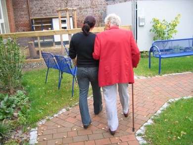 Image of senior family member walking with family