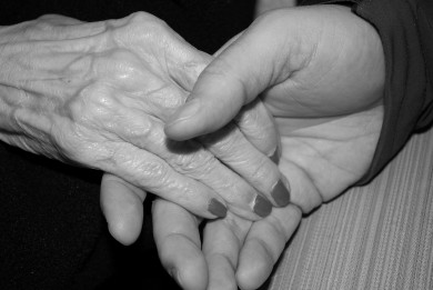 Holding hands with senior for comfort - who needs palliative care