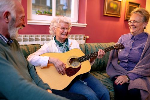 A group of seniors enjoying music therapy