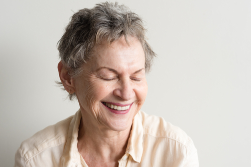 A woman with dementia smiling - Communicating Through Dementia